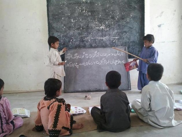 Children reading and writing Balochi